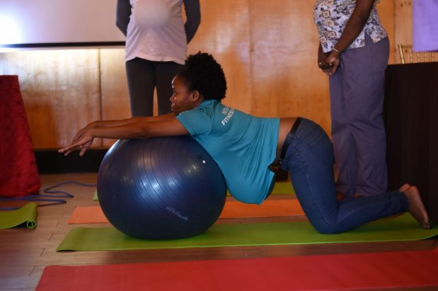 The healthcare professionals [trainees] practising exercise techniques to take back to health centres to teach pregnant adolescents