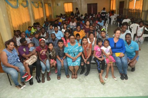 Minister of Public Health, Volda Lawrence seizes a quick photo opt with campers