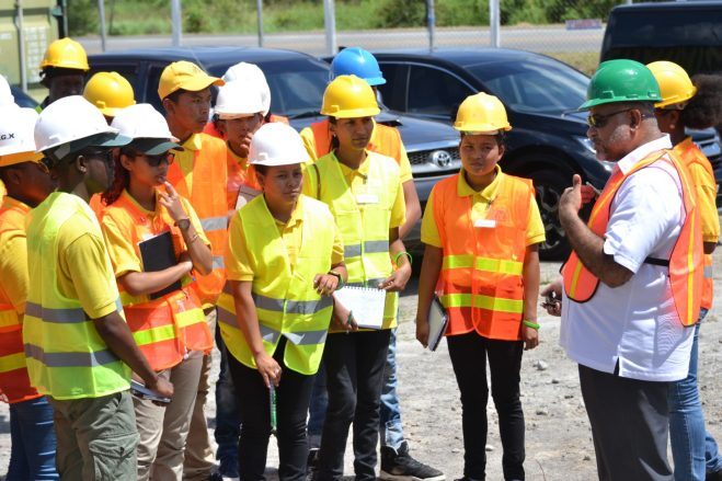 Executive Chairman of CGX Energy Inc., Professor Suresh Narine, engaging the Youths in Natural Resources at CGX Logistics Yard