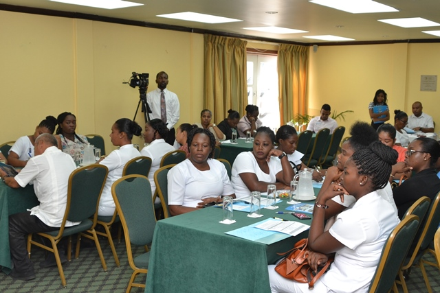 Trainees engaged at the adolescent health services refresher workshop.