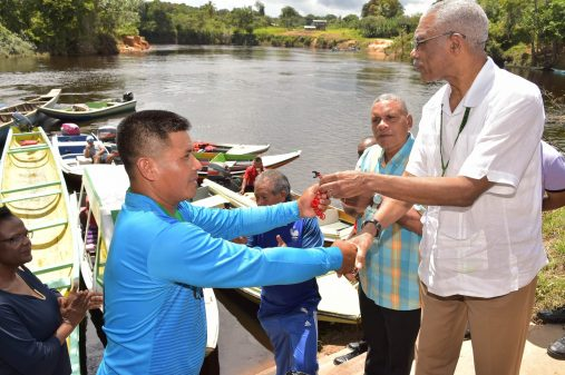 President David Granger hands over the key to the Toshao of Chinoweng Village, Roger Ronald