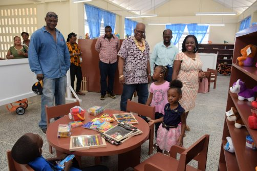 Minister Jordan and other officials tour the facilities of the Early Childhood Development Centre (ECDC)