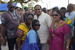 Prime Minister Moses Nagamootoo and his wife, Mrs. Sita Nagamootoo interacting with persons at the National Park yesterday during the Emancipation celebrations
