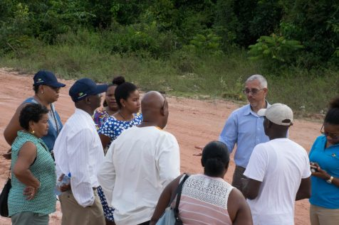 Minister of Business, Dominic Gaskin with some of the Kwakwani residents
