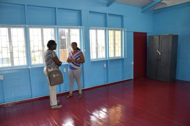 Minister of Education, Nicolette Henry [left] in discussion with Head Mistress of Tucville Secondary in the rehabilitated Home Economics room