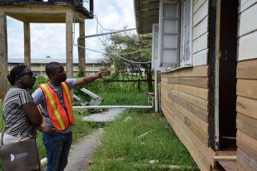 Minister of Education, Nicolette Henry and Special Projects Officer, Ron Eastman examining one of the buildings at the Cummings Lodge Secondary