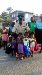 'D' Division Deputy Superintendent Patrick Todd with some of the recipients of the school bags