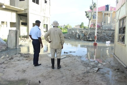 Director General (ag) of the Civil Defence Commission (CDC), Lt. Col. Kester Craig and Guyana Geology and Mines Commission (GGMC) official assessing the situation at the eruption site.