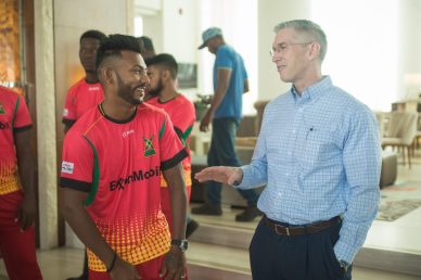 ExxonMobil's Country Manager, Rod Henson interacting with Devendra Bishoo of the Guyana Amazon Warriors team