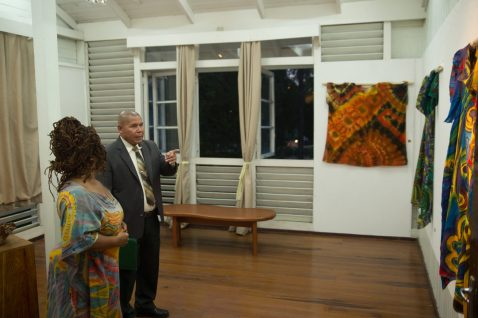 Tracy Douglas explaining one of the art pieces to Minister of Social Cohesion, Dr. George Norton