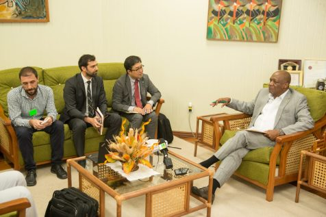 Minister of State, Joseph Harmon in discussions with representatives of Global Green Growth Institute