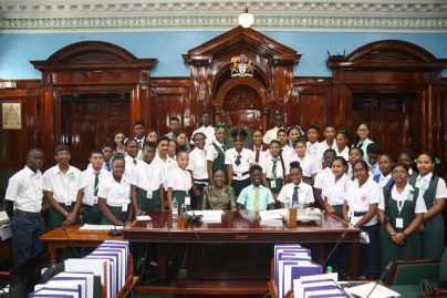 Secondary School Students, from across Guyana participating in the 4th Youth Parliament, take a picture with Minister of Education, Nicolette Henry