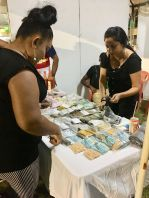 A customer samples a variety of spices that was produced in Berbice