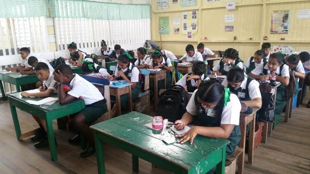 First formers of the Anna Regina Secondary School taking notes.