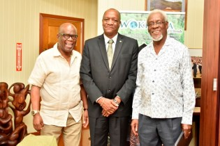 From left: Aide to Mr. Patterson, Mr. Alston Stewart, Minister of State, Mr. Joseph Harmon and former Jamaican Prime Minister, Mr. P.J. Patterson.