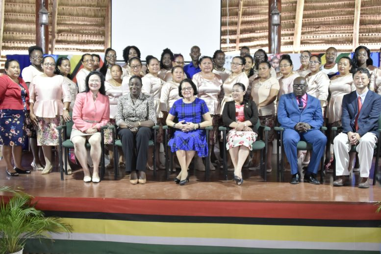 Seated from left: World Bank Task Team Leader, Ms. Hongyu Yang, Minister of Education Ms. Nicolette Henry, First Lady Mrs. Sandra Granger, Minister of Public Affairs, Ms. Dawn Hastings-Williams, Chief Education Officer, Mr. Marcel Hutson and Global Partnership for EducationCountry Head, Mr. Daisuke Kanazawa with participants of the programme