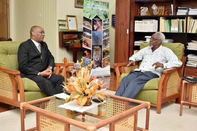 Minister of State, Mr. Joseph Harmon in discussion with former Prime Minister, Mr. P.J Patterson.