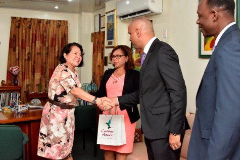First Lady Mrs. Sandra Granger greets CAL's Chief Executive Officer, Mr. Marvin Medera. Also in photograph are CAL's Senior Marketing Manager, Ms. Alicia Cabrera (second left) and Interim General Manager, Georgetown, Mr. Carl Stuart (right)