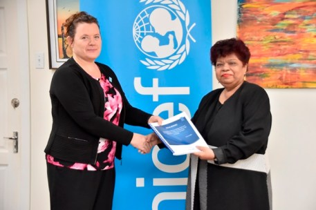 Minister of Social Protection, Ms. Amna Ally receiving the Study from UNICEF Country Representative, Ms. Sylvie Fouet.