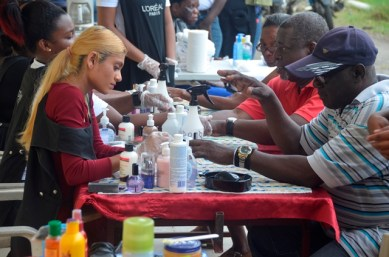 Senior citizens receiving manicures from cosmetology students of the Vryman's Erven Training Centre.