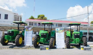 The three John Deere Double Drive Tractors donated to the Lethem Town Council, Linden Town Council and the Aranaputa Neighbourhood Democratic Council.