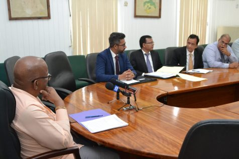 Minister of Finance Winston Jordan (left) with Guyana Association of Bankers' executives