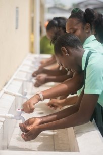 Students of the Charlestown Secondary School using the water bay.