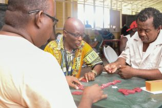 Residents engaging in the Domino friendly competition
