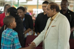 Prime Minister Nagamootoo greets a young attendee at the church service