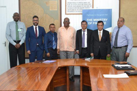 Minister of Finance Winston Jordan (pink) with GAB Executives
