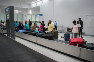 Passengers at the baggage carrousel at the New Arrivals terminal at the Cheddi Jagan International Airport (CJIA)