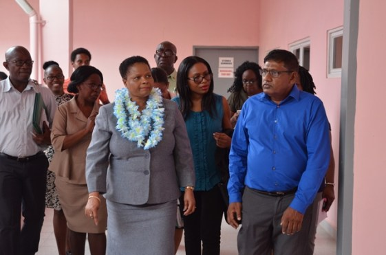 Minister of Public Health, Volda Lawrence and some of the members of the Health Management Committee along with a team from the ministry.