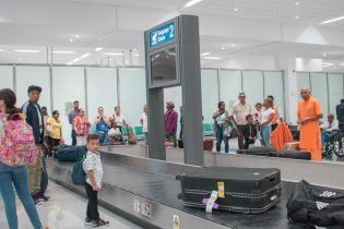 Passengers at the baggage carousel