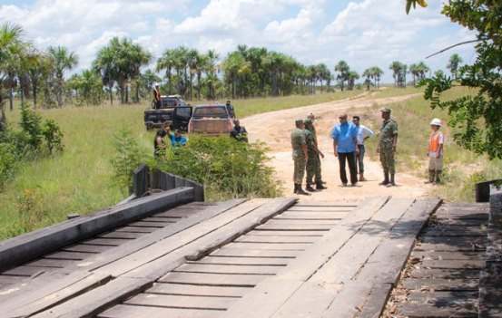 Minister of State, Mr. Joseph Harmon along with Director General of the Civil Defence Commission, Lieutenant Kester Craig, Commander of the Engineering Corps, Colonel Gary Beaton and engineers of the GDF and Ministry of Public Infrastructure inspect a bridge located approximately 20 minutes from the village of Karaudanawa.