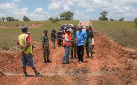 Minister of State, Mr. Joseph Harmon (third from right) and members of the reconnaissance team inspect this site along the Karaudanawa trail, where works have begun for the construction of a culvert.