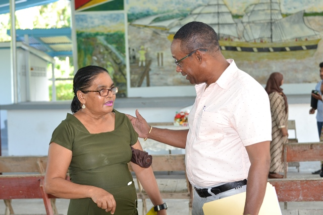 Commander of 'B' Division, Clifton Hicken interacting with one of the senior participants at the sensitisation programme.