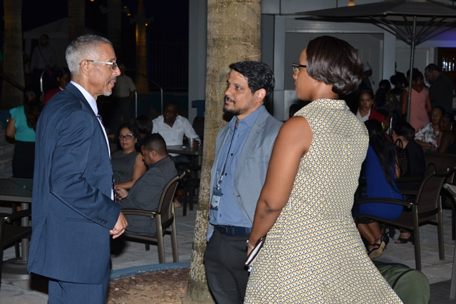 Minister of Business, Dominic Gaskin engaging with some of the buyers.