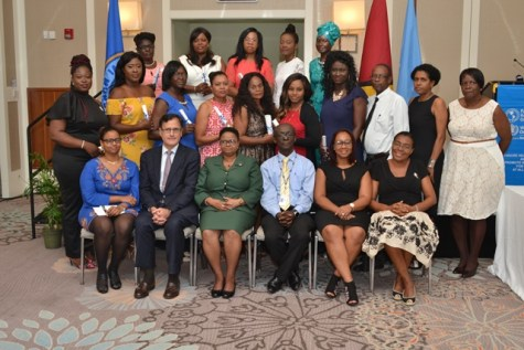 Scholarship awardees for both the Masters and Doctorate programme flanked by Senior nursing and Public Health Officials and those from PAHO/WHO and representative from the Brazilian Embassy in Guyana.