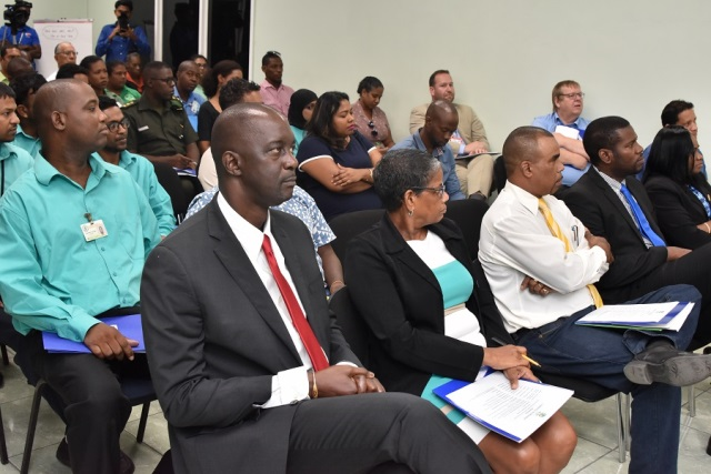 Commissioner and Chief Executive Officer of the Guyana Lands and Surveys Commission, Mr. Trevor Benn backed by participants of the Continuously Operating Reference Stations (CORS) Network Workshop.