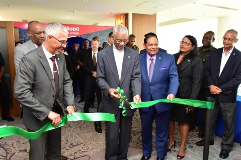 President Granger cuts the ceremonial ribbon to officially open the Guyana Trade and Investment Exhibition (GuyTIE) as Prime Minister Moses Nagamootoo, Minister of Business Mr. Dominic Gaskin and Minister of State Mr Joseph Harmon look on.
