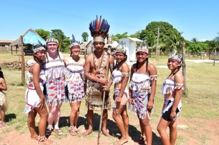 Chairman of the National Toshaos' Council Nicholas Fredericks (center) stands with some Rupununi dancers and members of the Peace Corps.