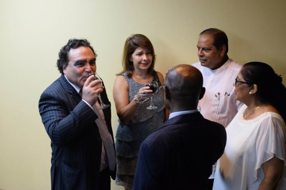 Outgoing Chilean Ambassador Claudio Rachel Rojas in conversation with Prime Minister Moses Nagamootoo and his wife, Mrs. Sita Nagamootoo, and Minister of Foreign Affairs, Carl Greenridge.