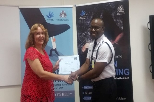 Foreign Service Officers Receiving TIP Training Certificate.