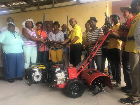 Public Relations Officer Food for the Poor Guyana, Wayne Hamilton, in the presence of NARIE Extension Officer, Candy Thomas and FFTP Region Six Representative, Alex Foster hands over the farming equipment to recipients of the 16 farming groups