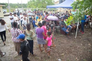 The scores of residents gathered outside the Yarrowkabra health post to benefit from the medical outreach