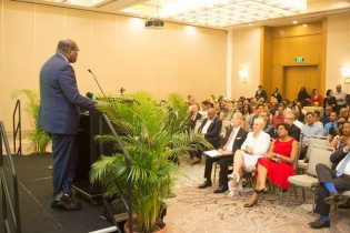 Managing Partner, Attorney-at-Law, Nigel Hughes addressing the audience at the launch of the Hughes, Fields and Stoby USA PLLC in Houston, Texas at the Guyana Marriott Hotel.
