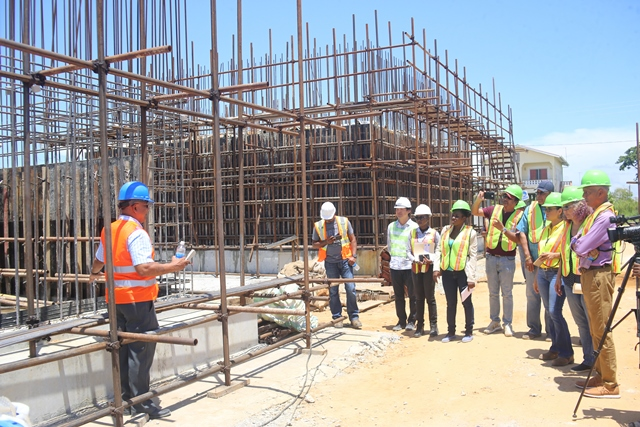 Consultant and Project Manager of Hyroplan, Richard Persaud, explaining works being done to Minister Bulkan, IDB Country Representative Sophie Makonnen, GWI's Managing Director, Richard Van West Charles among others.