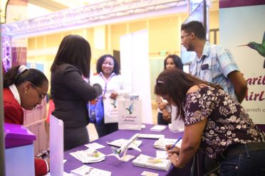 Patrons and buyers engaging exhibitors at GuyTIE