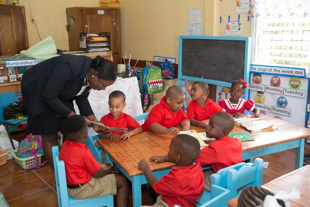 Minister of Education, Nicolette Henry interacts with students of the Edinburgh Nursery School.