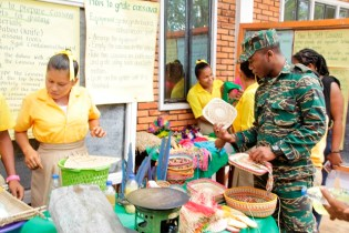 A GDF Officer observing one of the exhibits (Ministry of Education photo)